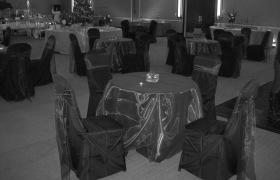 Black chair cover with purple sash, VA